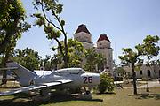 A fighter jet sits in a park outside a military building, Santiago de Cuba, Cuba. .