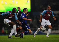 Photo: Tony Oudot/Sportsbeat Images.<br /> West Ham United v Everton. Carling Cup. 12/12/2007.<br /> Leon Osman of Everton is challenged by Luis Boa Morte of West Ham and watched by Hayden Mullins