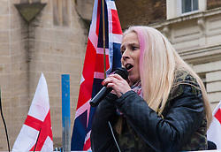 Whitehall, London, April 4th 2015. As PEGIDA UK holds a poorly attended rally on Whitehall, scores of police are called in to contain counter protesters from various London anti-fascist movements. PICTURED: A PEGIDA organiser addresses the few dozen anti-Islamists attending the PEGIDA UK London rally.