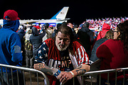 A supporter listens to the President's speech during a 'Make America Great Again' rally in Duluth, Minnesota, U.S. on Wednesday, Sept. 30, 2020. Trump and Democratic nominee Joe Biden began their first debate on an acrimonious note and quickly made it personal, with each candidate interrupting and talking over each other. Photographer: Ben Brewer/Bloomberg