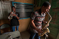 two young musician practicing at  humble studio. Mao Valderde, Dominican Reuplic.