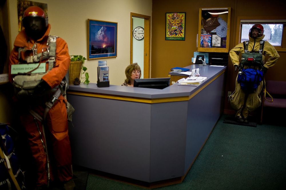 The reception desk at the McCall Smoke Jumper Base sits amongst mannequins displaying the difference between American and Russian smoke jumpers.