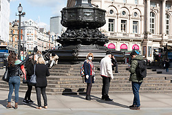 © Licensed to London News Pictures. 16/03/2020. London, UK. An almost empty  Piccadilly Circus as the Coronavirus outbreak affecting businesses and tourism in London. Photo credit: Ray Tang/LNP