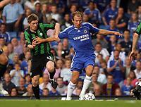 Photo: Chris Ratcliffe.<br /> Chelsea v Glasgow Celtic. Pre Season Friendly. 09/08/2006.<br /> Arjen Robben of Chelsea clashes with Mark Wilson of Celtic.