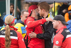 Prince Harry embraces Canadian competitor Nic Meunier as he attends the Archery Finals of the Invictus Games in Toronto, ON, Canada, on Friday September 29, 2017. Photo by Chris Young/CP/ABACAPRESS.COM