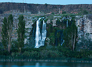 View of Thousand Springs Falls and Ritter Island at twilight during summer from Thousand Springs Resort in Hagerman, Idaho.