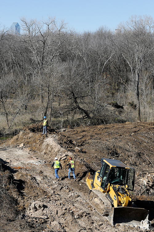 Kickapoo Empire LLC and DDM Construction Corporation begin moving dirt in the upper chain of wetlands in the Trinity River near Cedar Crest Blvd. in Dallas, Texas, on January 31, 2013.  The skyline of downtown Dallas can be seen just over the tree-line.  (Stan Olszewski/The Dallas Morning News)