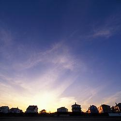 Sunset behind beach houses near Wallis Sands State Park.  Rye, NH.