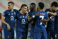 PIRAEUS, GREECE - DECEMBER 09: Matheus Uribe of FC Porto celebrates his goal with his teammates during the UEFA Champions League Group C stage match between Olympiacos FC and FC Porto at Karaiskakis Stadium on December 9, 2020 in Piraeus, Greece. (Photo by MB Media)