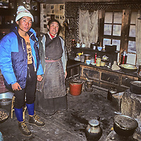 Sherpa Tsering Ongchu and his mother pose inside their family's kitchen in Namche Bazaar, a leading town of Nepal's Sherpa people. (Picture taken in September, 1980.)