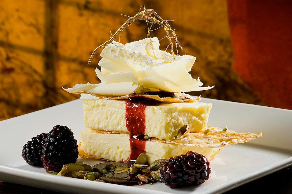 Key Lime Napoleon with shaved white chocolate, pistachios, berries and spun sugar.