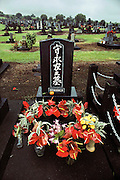 A grave decorated with flowers in Hilo, Hawaii.