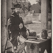 """We were at the Appomattox Court House national park on a very hot September day. This gentleman was the character interpreter for the military governor immediately after the surrender.  I'm scratching my head to remember the Captain's name.  He did a wonderful job in character.  We were advised to ask """"may I capture your image"""" or """"please strike a pose"""" because in the 1860s """"may I take your picture"""" would have been taken to mean I wanted to steal something!<br /> <br /> I decided to process this to look like it might have at the time."""