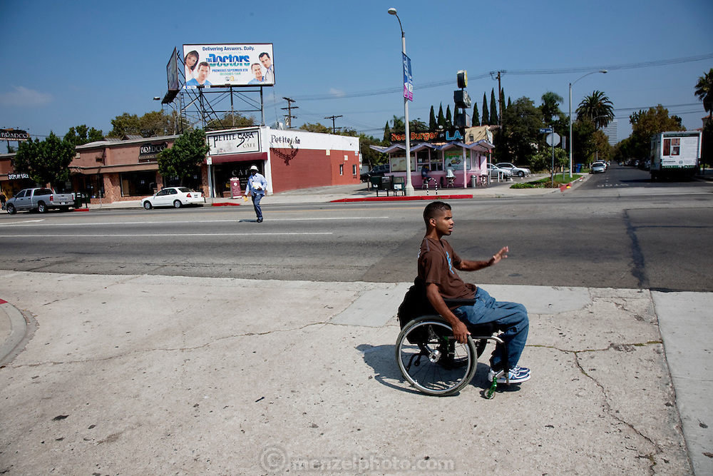 """Felipe Adams, a 30-year-old Iraq war veteran who was paralyzed by a sniper's bullet in Baghdad, goes for lunch at his favorite neighborhood café, Petite Sara, across busy West Pico Boulevard in Inglewood, California. (From the book What I Eat: Around the World in 80 Diets.) The caloric value of his day's worth of food on a day in the month of September was 2100 kcals. He is 30; 5'10"""" and 135 pounds. MODEL RELEASED."""