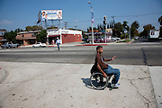 "Felipe Adams, a 30-year-old Iraq war veteran who was paralyzed by a sniper's bullet in Baghdad, goes for lunch at his favorite neighborhood café, Petite Sara, across busy West Pico Boulevard in Inglewood, California. (From the book What I Eat: Around the World in 80 Diets.) The caloric value of his day's worth of food on a day in the month of September was 2100 kcals. He is 30; 5'10"" and 135 pounds. MODEL RELEASED."