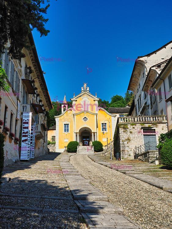 Santa Maria Asunta Church in Orta San Giulio town Italy at Lake Orta during a summer afternoon