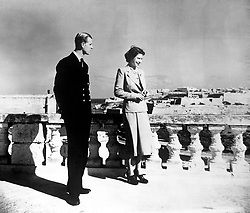 File photo dated 25/11/49 of Princess Elizabeth, accompanied by the Duke of Edinburgh, looking over Valetta from the roof of the Villa Guardamangia, Malta. The Royal couple will celebrate their platinum wedding anniversary on November 20.