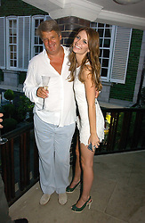 Actress MISCHA BARTON and her father PAUL at a party to celebrate FilmFour becoming the UK's first major free film channel held at Debenham House, Addison Road, London on 20th July 2006.<br /><br />NON EXCLUSIVE - WORLD RIGHTS