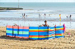 Holidaymakers on the beach at Viking Bay in Broadstaits, Kent.