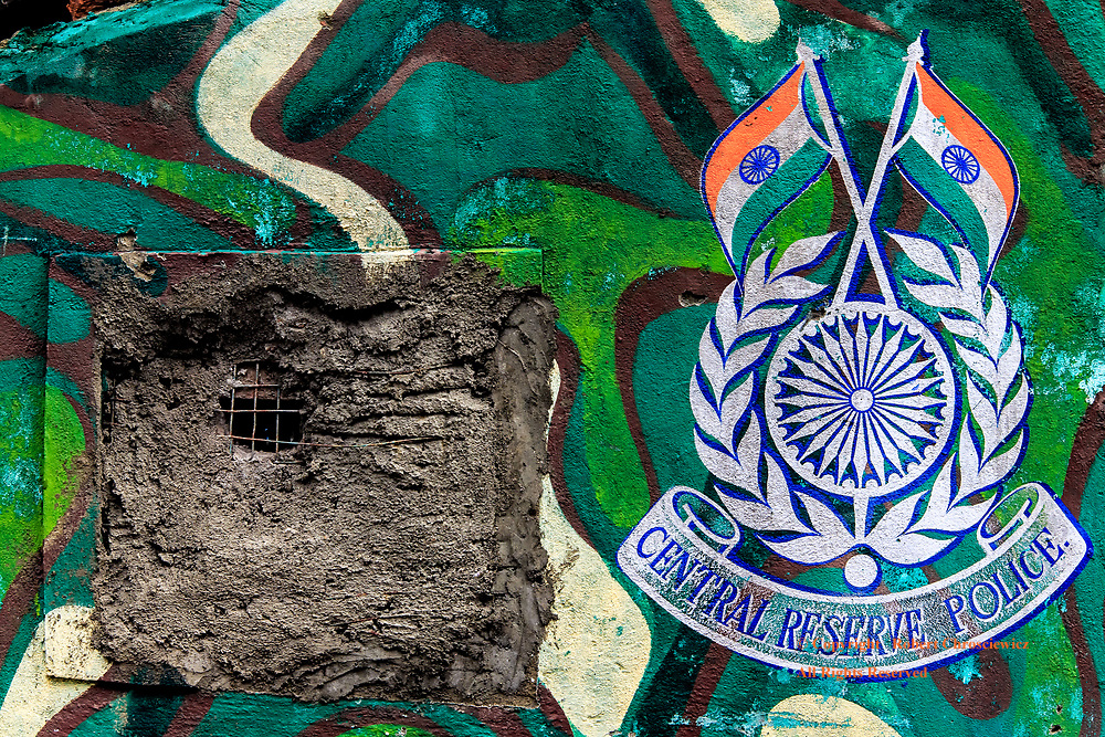 I Spy: This police station window reflects the level of conflict that pervades Kashmir, in Srinagar India.