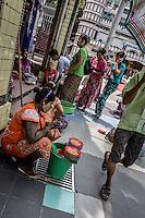 Yangon street sellers around the entrance of Sule Pagoda, Yangon, Burma.