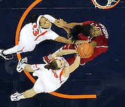 CHARLOTTESVILLE, VA- December 1: Sasha Chaplin #22 of the Indiana Hoosiers reaches for the rebound with Chelsea Shine #50 and Ataira Franklin #23 of the Virginia Cavaliers during the game on December 1, 2011 at the John Paul Jones Arena in Charlottesville, Virginia. Virginia defeated Indiana 65-49. (Photo by Andrew Shurtleff/Getty Images) *** Local Caption *** Chelsea Shine;Ataira Franklin;Sasha Chaplin