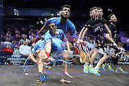 a multiple exposure image as Omar Mosaad of Egypt (wearing light Blue shirt) hits a shot against Mathieu Castagnet of France (wearing Black shirt) in the final.. the Final, Omar Mosaad of Egypt v Mathieu Castagnet of France , Canary Wharf Squash Classic 2016 , at the East Wintergarden in Canary Wharf , London on Friday 11th March 2016.<br /> pic by John Patrick Fletcher, Andrew Orchard sports photography.