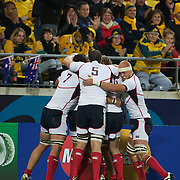 The USA celebrate a try by JJ Gagiano in front of the Australian fans during the Australia V USA, Pool C match during the IRB Rugby World Cup tournament. Wellington Stadium, Wellington, New Zealand, 23rd September 2011. Photo Tim Clayton.