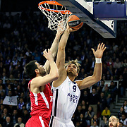 Anadolu Efes's Semih Erden (R) during their Turkish Airlines Euroleague Basketball playoffs Game 3 Anadolu Efes between Olympiacos at Abdi ipekci Arena in Istanbul, Turkey, Wednesday, April 17, 2013. Photo by Aykut AKICI/TURKPIX