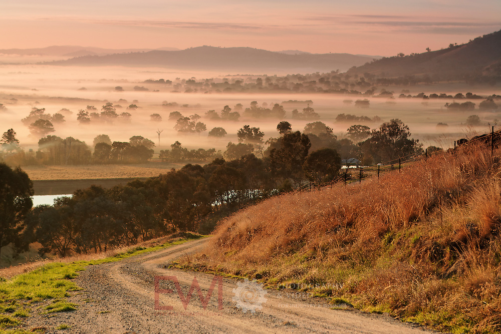 Sunrise over Eastern Victorian rural land.<br /> Larger JPEG + TIFF images available by contacting use through our contact page at :..www.photography4business.com