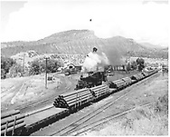 D&RGW loaded pipe train in Durango yard.  #478 is moving by on an adjacent track.<br /> D&RGW  Durango, CO