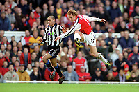 Ray Parlour shoots past Kieron Dyer to score his 1st and Arsenals 2nd goal. Arsenal 5:0 Newcastle United, F.A.Carling Premiership, 9/12/2000. Credit Colorsport / Stuart MacFarlane.