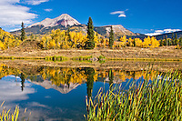 Reflections of 12,968 ft. Engineer Mountain in a small lake in the San Juan Mountains, Colorado.