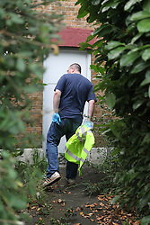 """© Licensed to London News Pictures. 11/08/2011. Harlington. London, U.K. Police are treating the deaths of a man and woman in their 20s as """"unexplained"""" after their bodies were discovered in a house. Scotland Yard was called to the property in Harlington, west London, after being alerted by someone concerned about the welfare of the pair yesterday. Photo credit : Rob Bourne/LNP"""