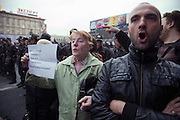 Moscow, Russia, 31/08/2010..Demonstrators shout slogans as police break up an opposition protest in central Moscow and arrest around 70 people. Opposition activists hold regular demonstrations on the 31st day of the month, protesting against restrictions on the freedom of assembly, which is protected by article number 31 of the Russian constitution.