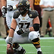 ORLANDO, FL - JANUARY 01:  Evan Boehm #77 of the Missouri Tigers sets the football during the Buffalo Wild Wings Citrus Bowl between the Minnesota Golden Gophers and the Missouri Tigers at the Florida Citrus Bowl on January 1, 2015 in Orlando, Florida. (Photo by Alex Menendez/Getty Images) *** Local Caption ***  Evan Boehm
