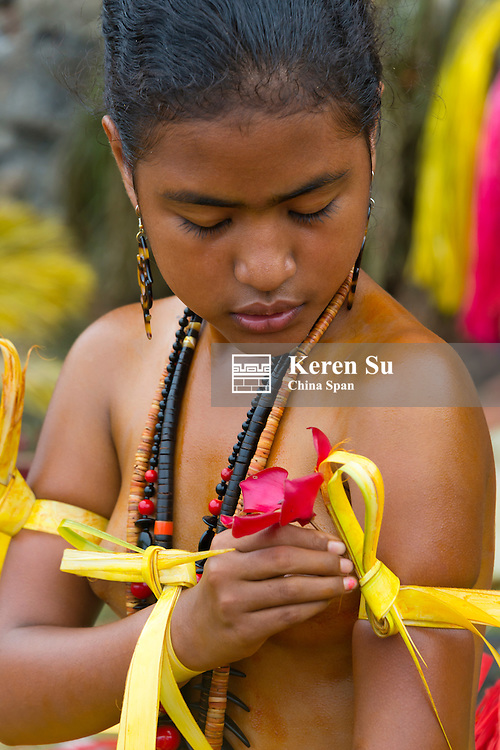 Yapese girl preparing for the Yap Day Festival, Yap Island, Federated States of Micronesia