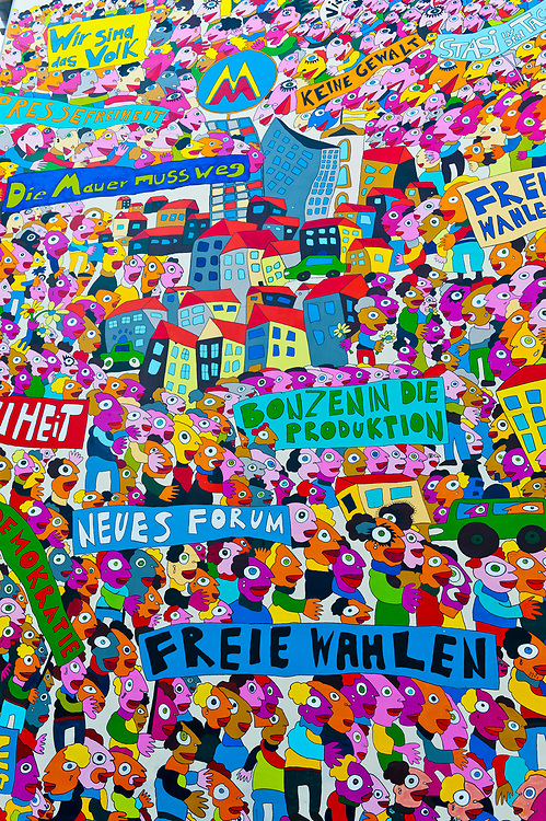 A graffiti mural depicting East and West Germany and the Fallof the Berlin Wall, Leipzig, Saxony, Germany
