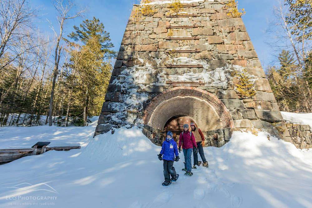 A family checks out the Tahawus Blast Furnace, which became operational in 1854 and produced iron (though only for two years) from iron ore mined locally in New York's Adirondack Mountains. Newcomb, New York.