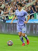 NEWCASTLE UPON TYNE, ENGLAND - SEPTEMBER 17: Daniel James of Leeds United brings the ball forward during the Premier League match between Newcastle United and Leeds United at St. James Park on September 17, 2021 in Newcastle upon Tyne, England. (Photo by MB Media)