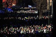 Thousands of fans walk next to CenturyLink Field during the Seattle Seahawks victory parade in Seattle Wednesday, Feb. 5, 2014. <br /> By Erika Schultz / The Seattle Times