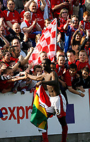 Photo: Paul Greenwood.<br />Accrington Stanley v Macclesfield Town. Coca Cola League 2. 28/04/2007.<br />Accrington's Godwin Antwi celebfrates victory at fullt ime with the Accrington fans