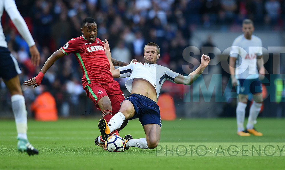Jordan Ayew of Swansea City is challenged by Eric Dier of Tottenham Hotspur during the premier league match at the Wembley Stadium, London. Picture date 16th September 2017. Picture credit should read: Robin Parker/Sportimage