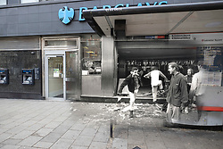 © Licensed to London News Pictures. 25/03/2020. London, UK. In this combined image looters break into a branch of Barclays Bank on Charing Cross Road during the London poll tax riots on March 31st 1990 overlaid on the same location today. The protest on the last day of March in 1990 started peacefully when thousands gathered in a south London park to demonstrate against Margaret Thatcher's Government's introduction of the Community Charge - commonly known as the poll tax. Marchers walked to Whitehall and Trafalgar Square where violence broke out with the trouble spreading up through Charring Cross Road and on to the West End. Police estimated that 200,000 people had joined the protest and 339 were arrested. The hated tax was eventually replaced by the Council Tax under John Major's government in 1992.  Photo credit: Peter Macdiarmid/LNP