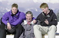File photo dated 7/4/2000 of the Prince of Wales and his sons, Prince William (left) and Prince Harry, posing for photographers on the Madrisa ski slopes above Klosters in Switzerland.