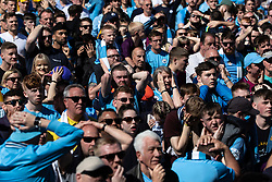 © Licensed to London News Pictures . 12/05/2019. Manchester , UK . Brighton go 1-0 up . Manchester City supporters watch the club's Premier League match at Brighton on a big screen in City Square at the Etihad Stadium. If Manchester City win the match they will win the title for the second time in a row . Photo credit : Joel Goodman/LNP/LNP