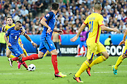 SAINT-DENIS, FRANCE, 06.10.2016 - FRANCE-ROMANIA - Dimitri Payet (the ball) of France during bid against Romania in a match valid for the 1st round of Group A of Euro 2016 in the Stade de France in Saint-Denis , on Friday (10)