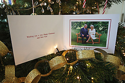 The 2018 Christmas card of the Prince of Wales and Duchess of Cornwall on a Christmas tree in Clarence House, London. The card features a photograph of the royal couple, taken by Hugo Burnand in the gardens of Clarence House.