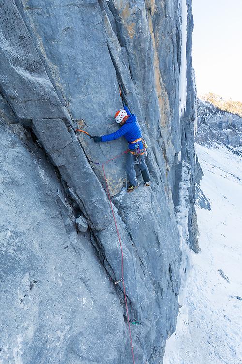 Jeff Mercier climbing the first pitch of Buddha Nature, M6 110m - Storm Creek - BC