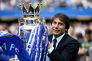 Chelsea Manager Antonio Conte celebrates with the trophy during the Premier League match between Chelsea and Sunderland at Stamford Bridge, London, England on 21 May 2017. Photo by Andy Walter.